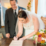 Signing marriage certificate at wedding venue