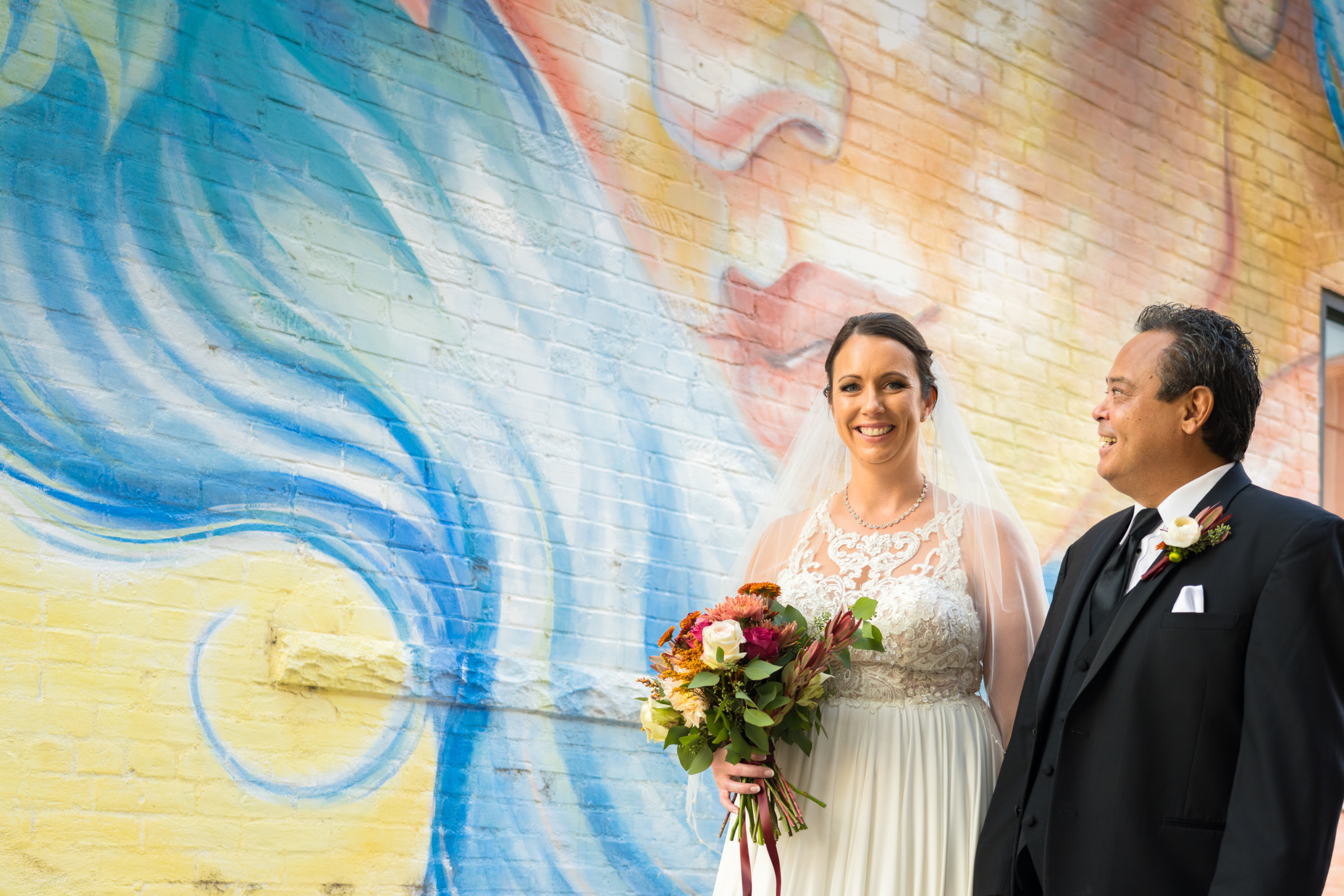 Ladyface Mural in Downtown Loveland with Bride and Groom
